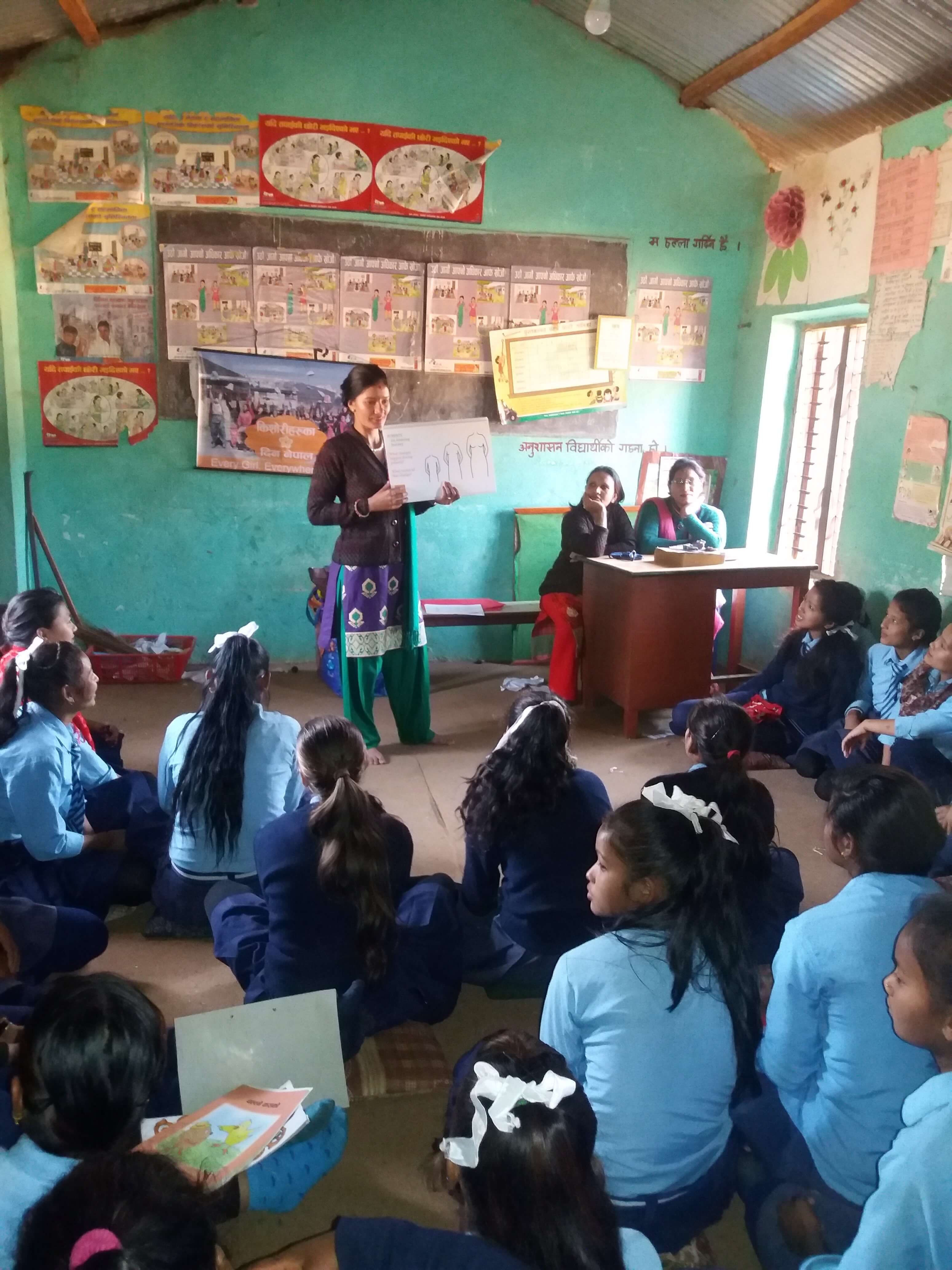 A trainer teaches the Girls' Menstrual Health Education Program in Dhading, at Days for Girls, a school in the Himalayans.