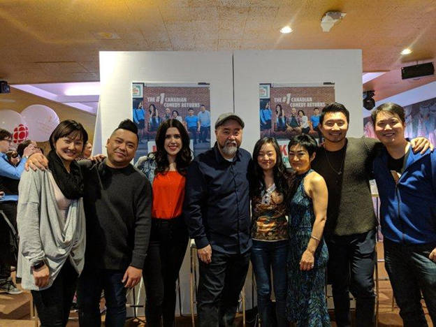 "Photo of ""Kim's Convenience"" cast with Mike Yuan and Ruby Yuan."