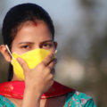 Photo of a South Asian woman wearing a face mask. The Indian COVID-19 crisis is taking a heavy toll on the diaspora too.