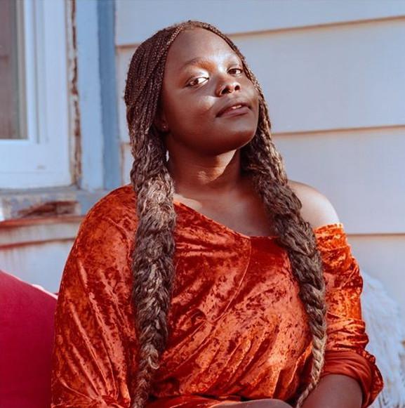 "Photo of Francesca Ekwuyasi, author of ""Butter Honey Pig Bread"""