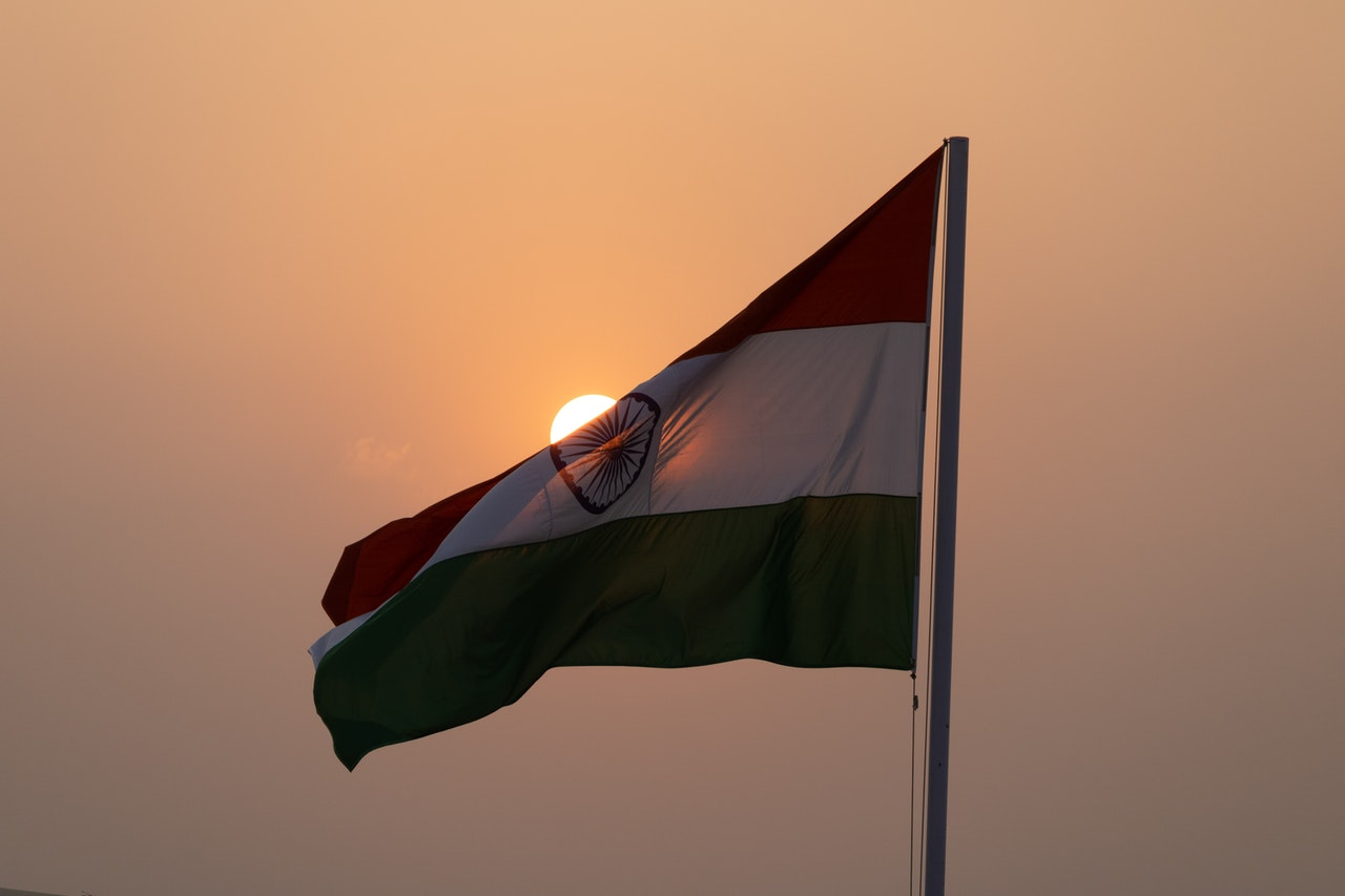 Photo of Indian flag against the sky. Former ambassador describes the pandemic situation in India.