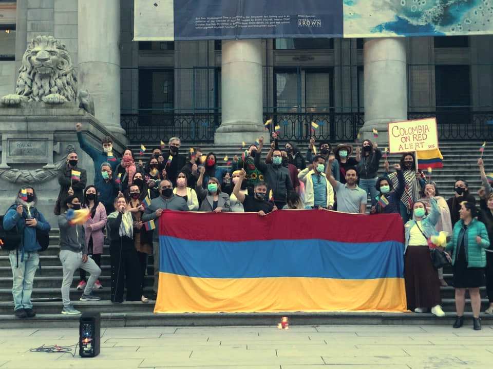 Activists pose for photo for Colombia