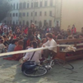 People in a square in Italy.