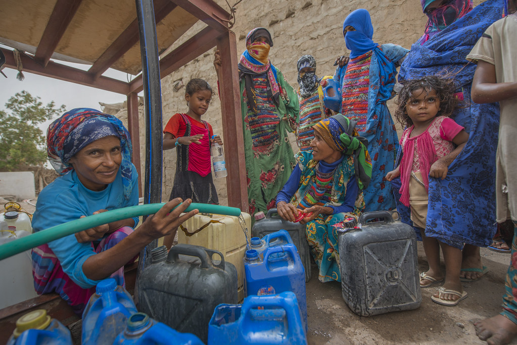 People fetch water provided by Solidarités International, an EU-supported aid group, in Yemen's Hodeida Governorate.