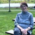 Canadian activist Jill Carr-Harris sits on a park bench.